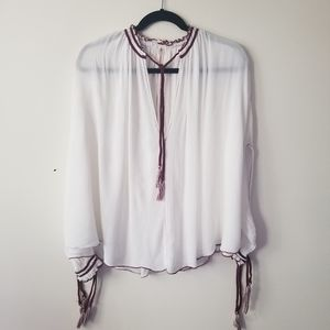 Free People blouse oversized with tassles sz S